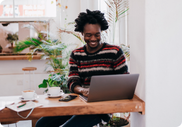 Smiling person with laptop